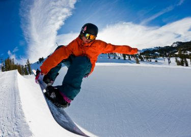 Young Kid Snowboarding