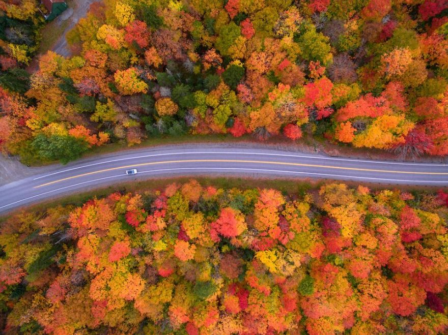 Aerial view of the Scenic drive and the beautiful Fall colors of New Hampshire. I used a drone to capture the fall colors that cannot be seen from the road. (Photo And Caption By Manish Mamtani / National Geographic Travel Photographer Of The Year Contest)